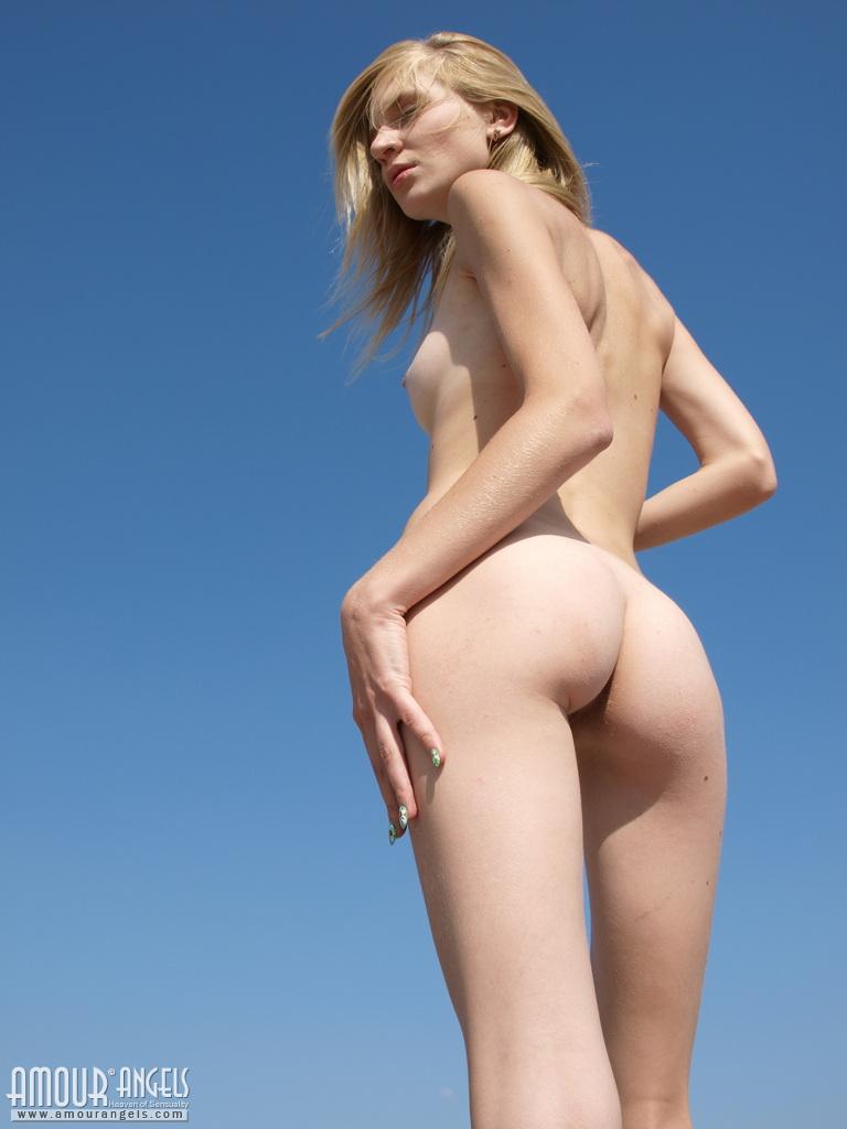 Thin girl on nude beach