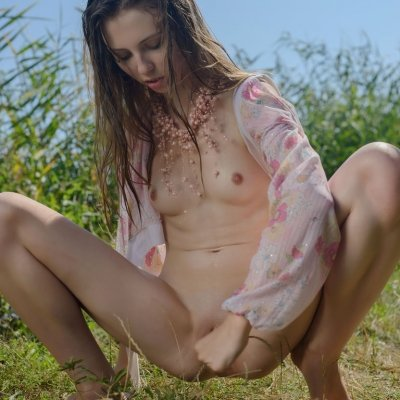 Horny young skinny teen Catalina nude outside showing her smooth pussy