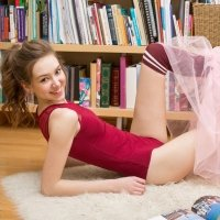 Adorable young thin girl Galina undresses to show her skinny nude body