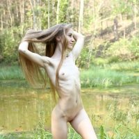Slender and toned Larisa nude has such a nice round ass