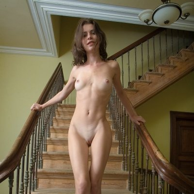 Beautiful young slim girl nude on the stairs Jadi