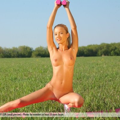 Little slim girl aerobics naked outdoors