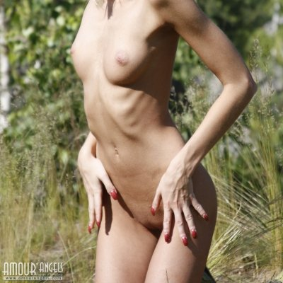 Young skinny girl naked in the sun