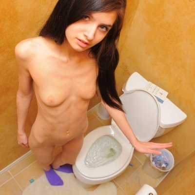 Little girl peeing in the toilet