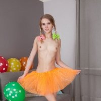 Slim and petite girl Lili naked in the living room